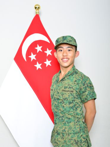 Me taking the mandatory shot with the national flag before passing from the BMT.