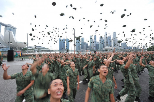 Recruits tossing their jockey caps with joy!