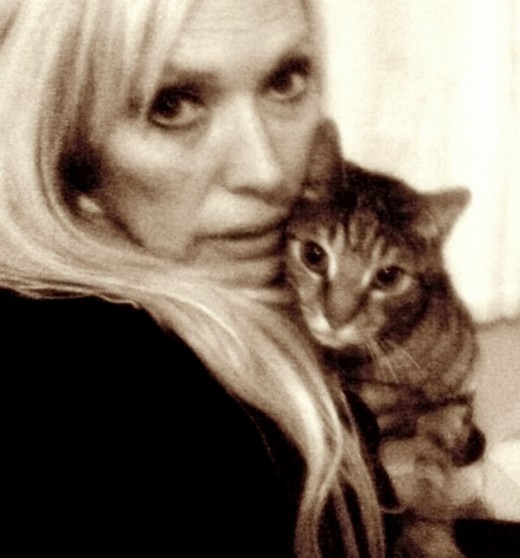 Me with Pepper - the stray cat who joined six dogs in my house and soon made himself at home.