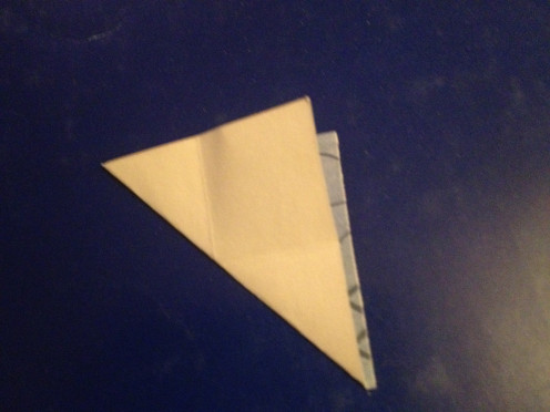 3. Fold in half with corners and back sides together.
