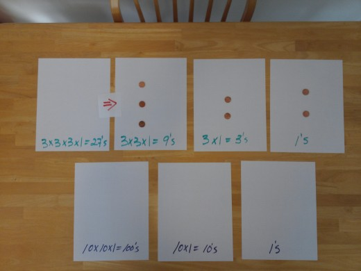 Step 1 is to swap 1 - 27's place value token for 3-9's place value tokens.