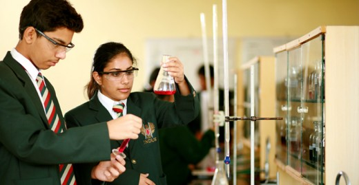 Students performing an experiment in a High School Chemistry Lab
