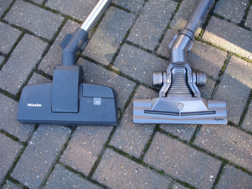 Miele and Dyson vacuum cleaner heads - top view