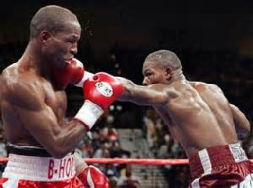 Jermain Taylor (right) beat Bernard Hopkins both times they fought in the ring. Taylor is a two time 160 pound world champion in the sport of boxing.