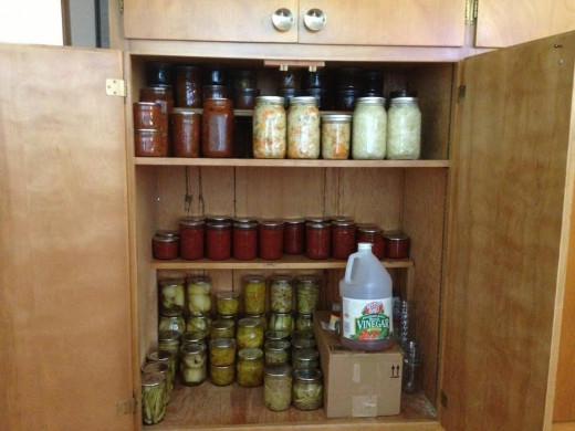 The top shelf has 5 jars of naturally fermented Kimchi and Kraut.  to reduce spoilage, I will probably move them to the refrigerator once I am sure fermentation is over.