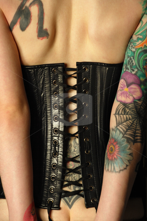 Tattooed women in leather corset