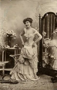 Victorian woman in tight corset and multi-layered dress