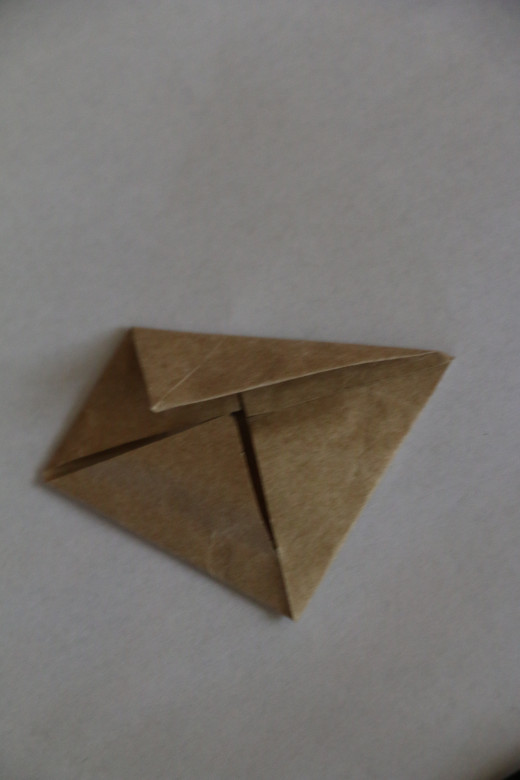 Fold two sides to the centre to make a kite shape