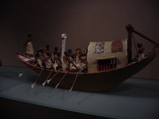 Traveling boat  made of wood, paint, plaster, linen twine and cloth.  This boat was found in a hidden chamber at the side of the passage leading into the rock cut tomb of the royal chief steward Meketre.