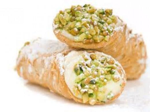 Traditional Canoli with pistachio garnish