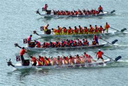 Dragon Boat Racing is similar to a canoe race except with a team of rowers on a much bigger boat.