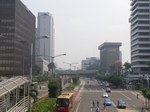 View of Thamrin Street with the busway lane and bus at the centre