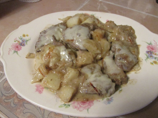 Liver & Onions a'Fromaggio with potatoes ready to eat.