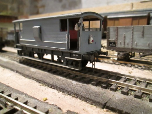 Dapol ex-LMS brake van repainted from bauxite livery to unfitted grey, fitted with  Smiths' 3-link couplings, Springside lamps and hand-painted Dapol (Airfix) plastic guard (was a porter to be attached to a barrow but I ditched that - not realistic)