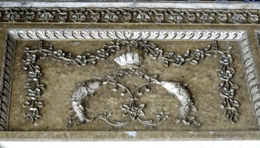 Fish motif in stucco