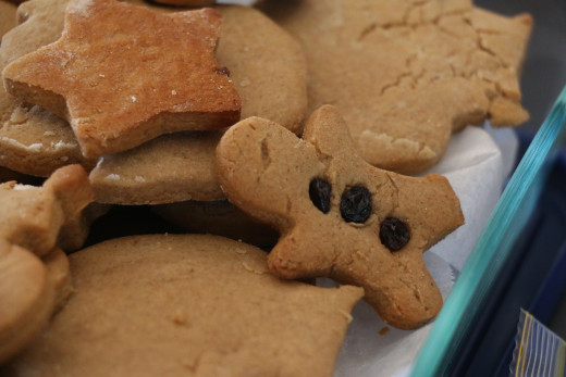 Gingerbread man with dried fruit buttons instead of icing - regular gingerbread is quite sugary but alternative recipes can be used.