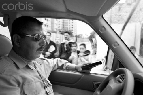 Iraqui police officer watches highway to see if there is any traffic violations