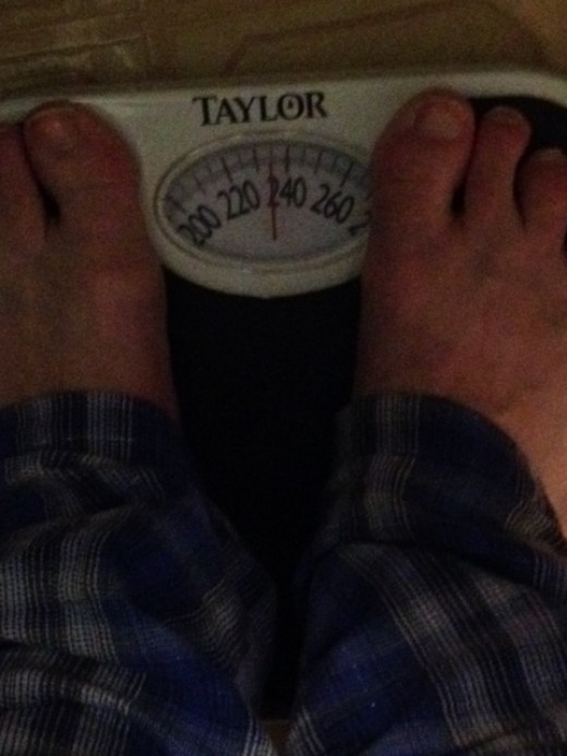 There I am again - on the scale - down 2 pounds - woo hoo!