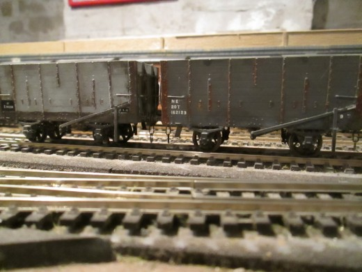 A pair of the 20 ton wood-built North Eastern hoppers that appeared before the turn of the 20th Century, Slaters' kits in (left) British Railways and (right) LNER livery with Smith's 3 link couplings, well weathered