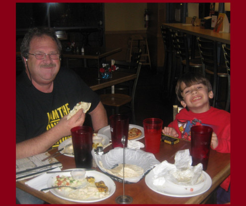 Misti's Dad Bill Green, having a great time indulging in Mediterranean Cusine with his adorable grandson.