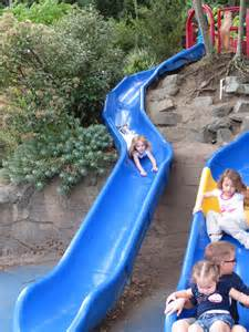 oh........and one of the funnest playgrounds ever!!!!!! Older kids will love to climb on the jungle gym while younger tots will love the slide, turtle sandbox, log crawling zone, animal figurines, and lily pad spray area zone!!!!!!!!!!!!!!!!!!