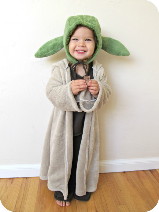 Funny how mom's waist-length fuzzy sweater is a floor-length budda-esque robe for tots, along with a pair of homemade stuffed ears, or a possible halo, headband, turban, or any mixture of fun headgear leads to boundless  characters.