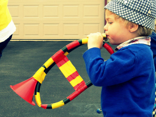 Tape together a long car oil funnel with duct tape for a fun and impressive horn.