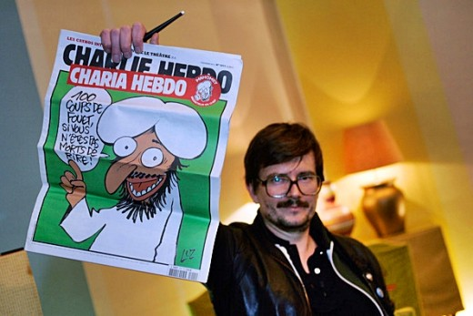 A man with a copy of satirical weekly newspaper Charlie Hebdo, which was the target of the terrorists