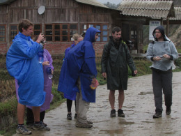 Our trekking group warding off the rain