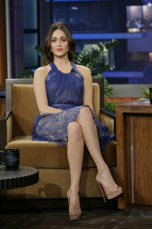 Emmy Rossum oin a pretty blue dress and nude Louboutin heels on late night TV talk