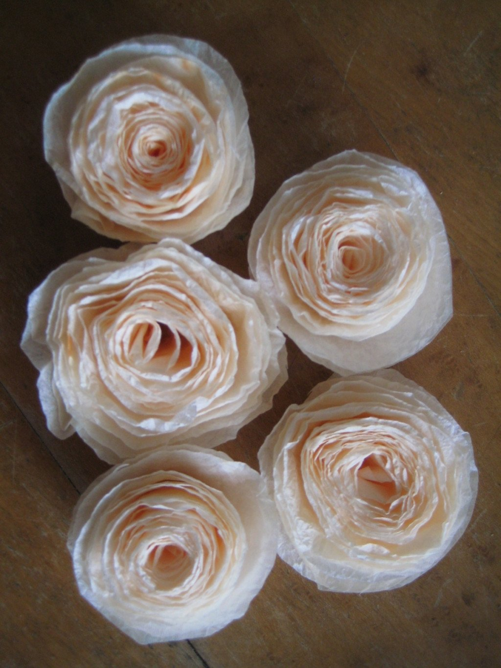 + 4 coffee filters per rose + scissors + floral wire – 1 stick per rose and they appear to be numbered. Can you please sent me the pattern for the petals. Thanks, and keep up the awesome work. These are o beautiful. Camilla 2Pingbacks & Trackbacks on Coffee Filter Roses.