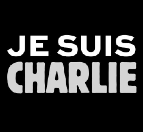 The message #Je suis Charlie. Solidarité.  Many gathering for peaceful rallies carry this in their hands or raised as a placard