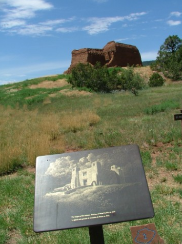 Approach the ruins of the Spanish Mission from the visitor center and you will find a depiction of what the mission looked like when it was active at Pecos National Historical Park near Santa Fe, New Mexico.