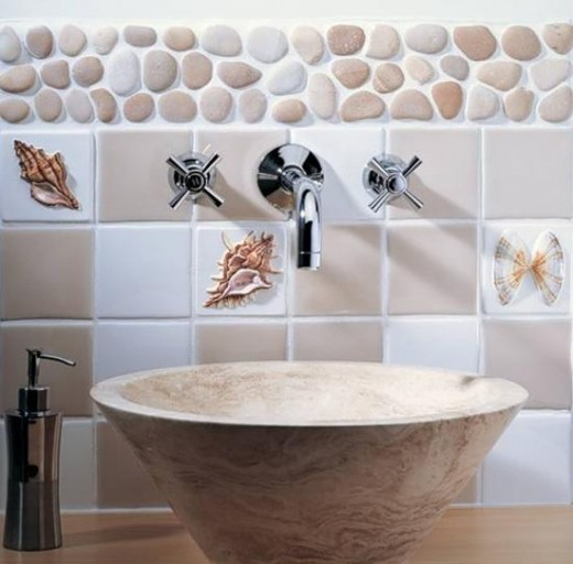 Polished stones can also be used in splashback areas. Tiles with shell themes are available, but why not use real shells instead!