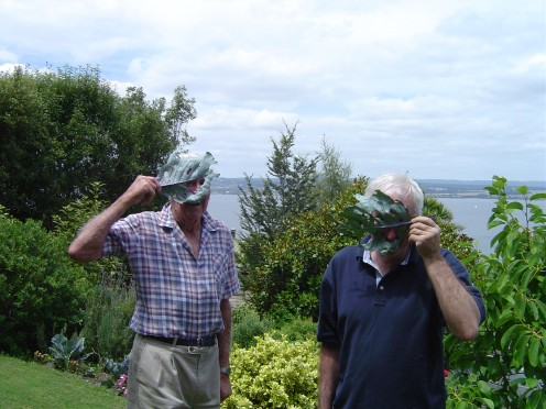Father and Son have fun with my poor caterpillar eaten cabbages!