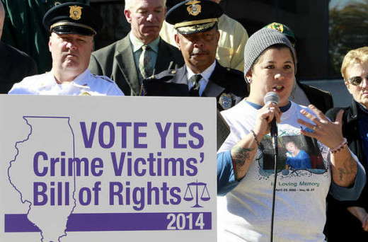 """Tanya Brown of Belleville speaks Wednesay during the rally for a crime victims' bill of rights. Brown's grandmother Yoko Cullen was murdered in 2011.""  Steve Nagy."