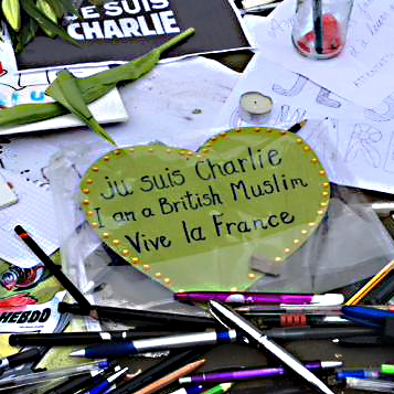 Tributes paid, including a collection of pens and pencils - the journalist's tools, and a heart shaped message from a British Muslim