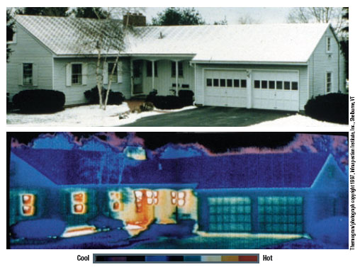 A  thermal photograph showing heat leaking from a house during those cold winter months. The white, yellow, and red colors show heat loss.