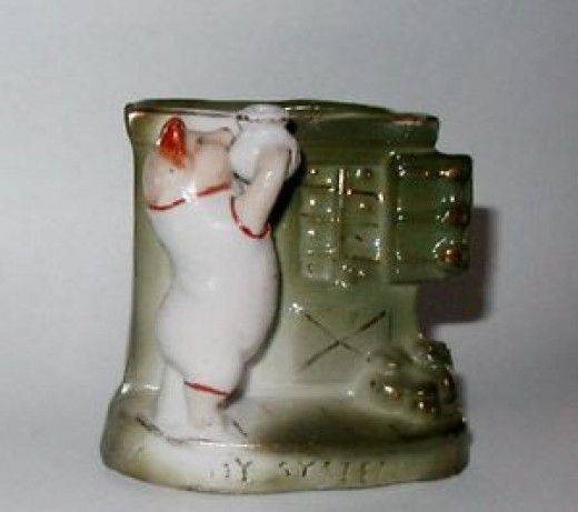 Rare. Piggy pouring something from a vase into a cabinet I believe. Sold for $55.