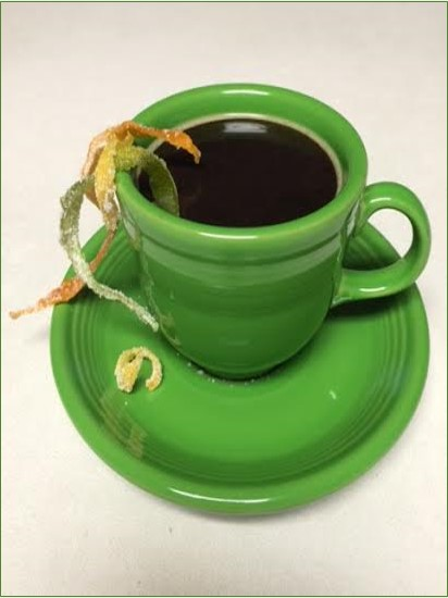 Coffee with candied zest garnish