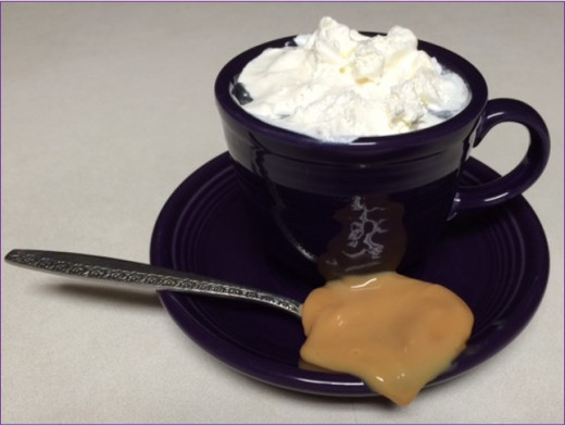 Coffee with whipped topping and dulce de leche