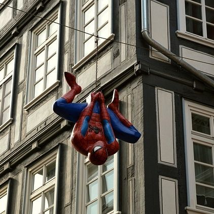 Spiderman dangling from his web.
