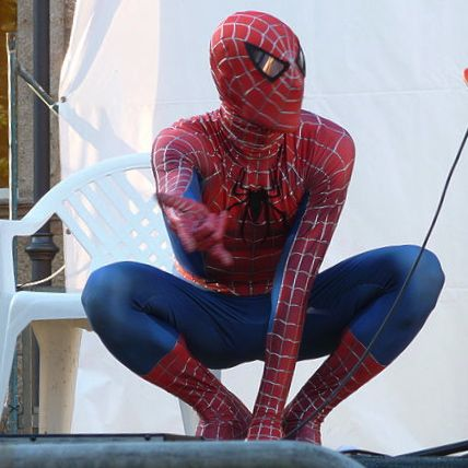 Spiderman in his crouch preparing to shoot his web.