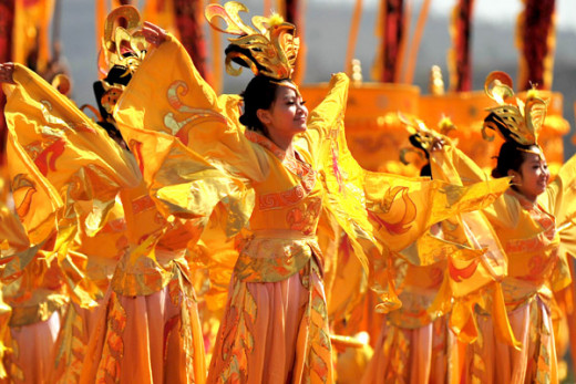 Dancers perform during a ceremony to honor Huangdi , the Yellow Emperor , in Huangling county of Northwest China ' s Shaanxi