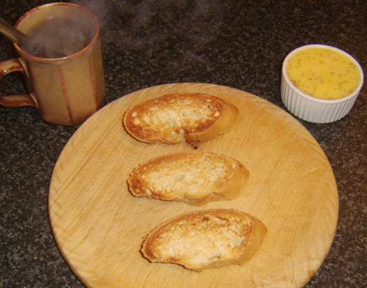 Spreading rainbow trout butter on hot toast with knife heated in boiling water