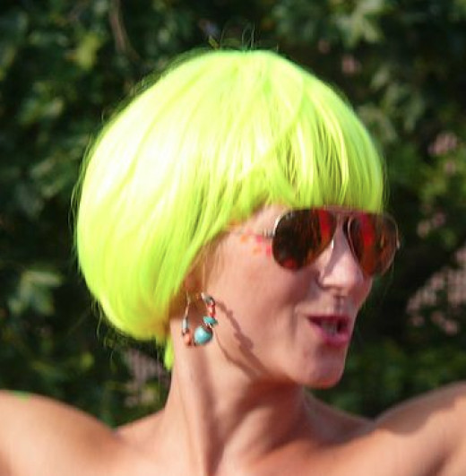A woman wearing a neon yellow wig at a street parade in 2011. This photo has been cropped. To see the larger, original version, click the source below.
