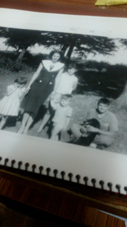 My two oldest sisters and brother are with ma in the picture.  I am holding a dog.  My youngest sister, Connie, wasn't born yet.