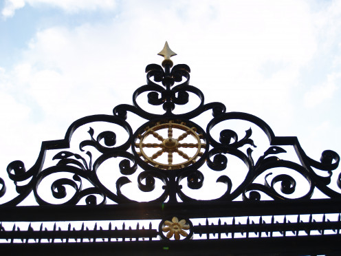 The front gate of St. Catharine's College, Cambridge with a Catharine Wheel