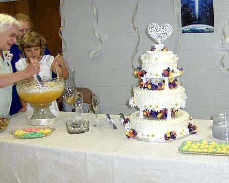 There was no fancy, tiered cake at my parent's wedding. This one is from a granddaughter's wedding many years later.  Gail and Clyde had a simple angel food cake for their nuptials.