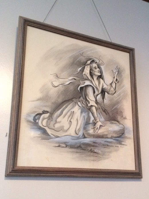 An artist's drawing of the witch Moll Dyer. Notice the rock under her right hand.